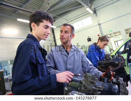 Mechanics training class with teacher and students - stock photo