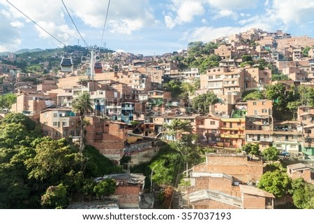 Medellin cable car system connects poor neighborhoods in the hills around the city. - stock photo