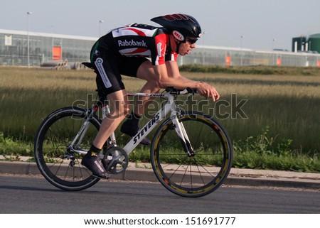 MEDEMBLIK, NETHERLANDS - MAY 25: Cylist during time trial matches in  may 25, 2011 in Medemblik, The Netherlands. - stock photo