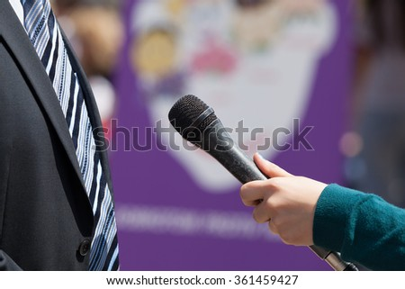Media interview with businessman - stock photo