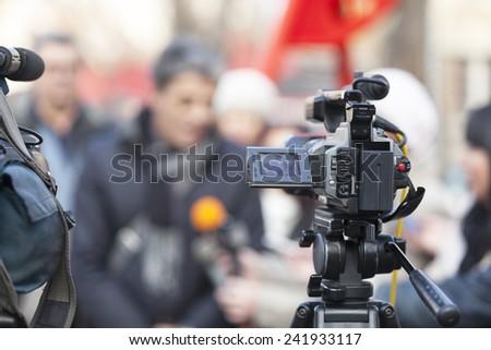 Media scrum. Impromptu press conference. - stock photo
