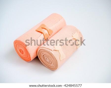 Medial elastic bandage two sizes on white background - stock photo