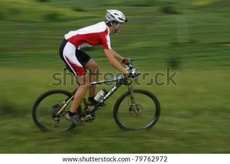 MEDIAS, ROMANIA, -JUNE 11: Unidentified mountainbiker during competition on June 11, 2011 at Medieval Mountainbike Marathon in Medias, Romania. - stock photo