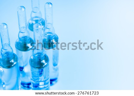 Medical ampules for vaccination or injections, close up, selective focus - stock photo