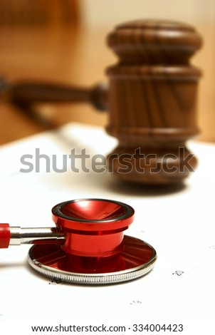 Medical and legal systems come together in this still life. - stock photo