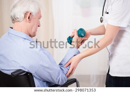 Medical assistance for an elderly person in a wheelchair - stock photo