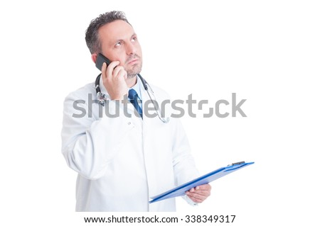 Medical assistance over the phone concept with doctor or medic talking on smartphone - stock photo