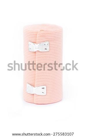 Medical bandage roll on white background. - stock photo
