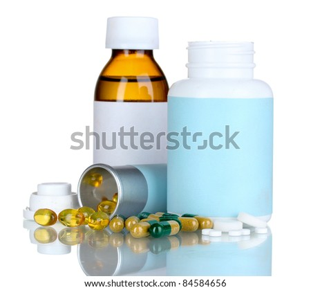 Medical bottles and pills isolated on white - stock photo