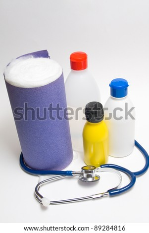 Medical bottles with cotton and stethoscope - stock photo