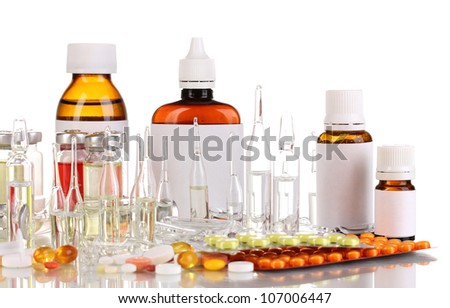 Medical bottles with medical ampoules and tablets isolated on white - stock photo