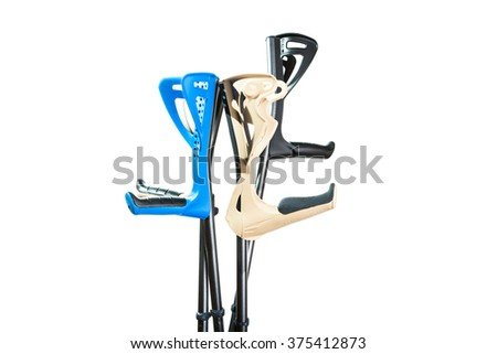 Medical cane on a white background, helps to recover faster. - stock photo