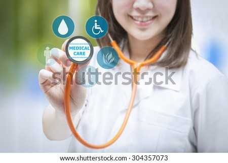 medical care concept  with doctor showing stethoscope - stock photo