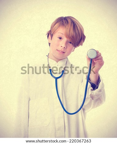 Medical child auscultating - stock photo