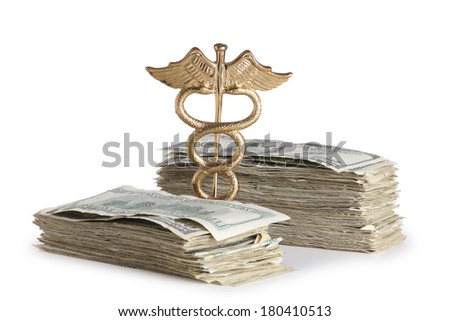 Medical concept, caduceus and stack of money cut out on white background - stock photo