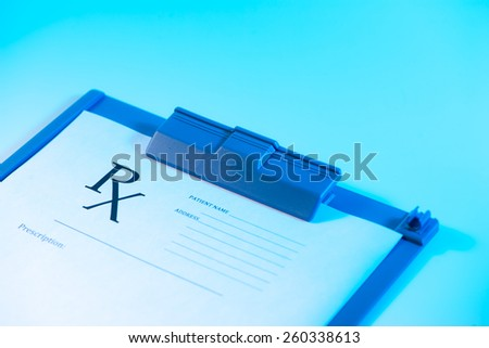 Medical concept. Empty medical prescription on blue reflective background - stock photo