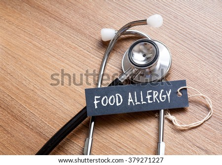 Medical Concept-Food Allergy word written on label tag with Stethoscope on wood background - stock photo