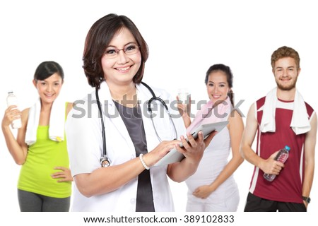 Medical doctor and people doing exercise at the background and drinking water. Isolated on white - stock photo