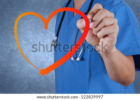 medical  doctor drawing heart symbol - stock photo
