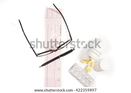Medical doctor.Electrocardiogram Result ,medicine,bottle,glasses,pen,isolated on the white background. - stock photo