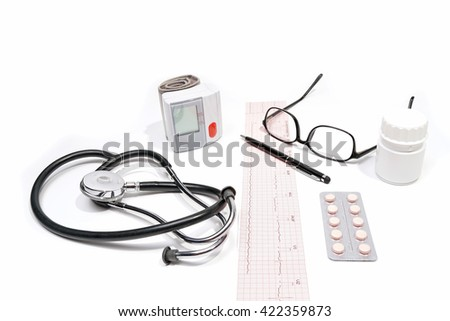 Medical doctor.Electrocardiogram Result ,medicine,bottle ,stethoscope, sphygmomanometer ,glasses,pen,isolated on the white background. - stock photo