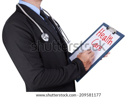 medical doctor filling out health care word on white background with clipping path - stock photo