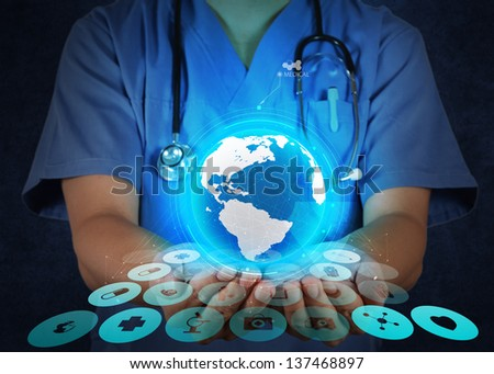 Medical Doctor holding a world globe in her hands as medical network concept - stock photo