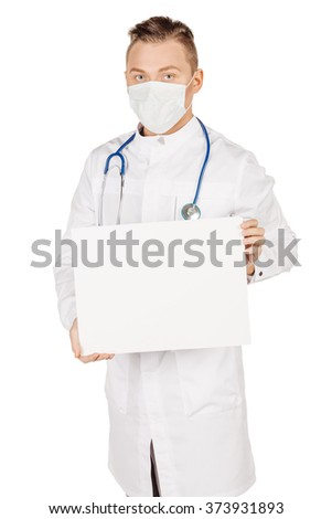 Medical doctor in white coat with stethoscope and mask holding blank poster, presenting and showing copy space for product or text. Isolated over white studio background. background. - stock photo