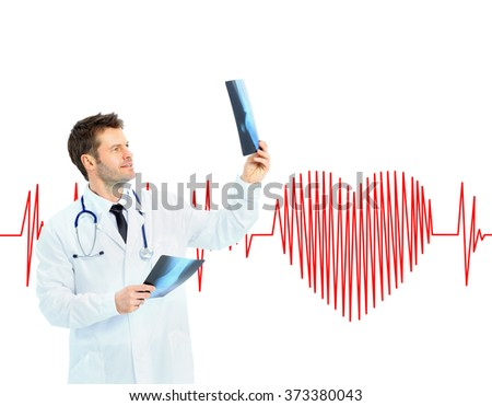 Medical doctor looking at a x-ray image in the office - stock photo