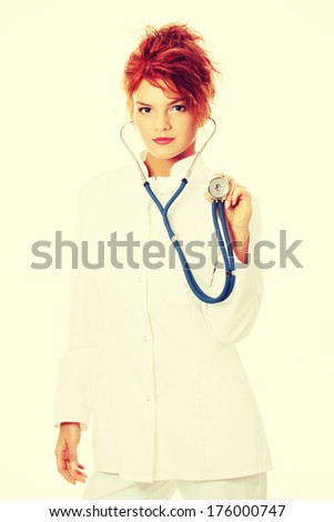 Medical doctor or nurse with stethoscope. Isolated on white background - stock photo