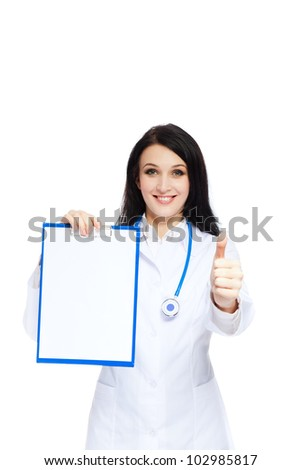 medical doctor woman smile with stethoscope clipboard show thump up finger, concept of advertisement product, empty copy space. Isolated over white background - stock photo