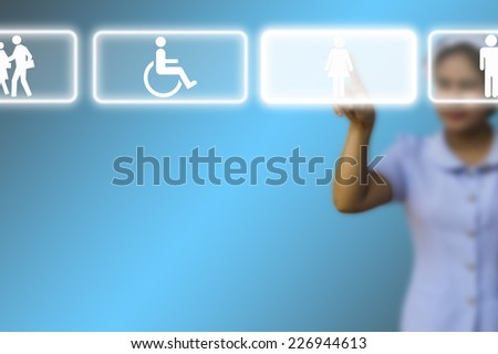 Medical doctor woman use innovative technologies and touch empty touchscreen with icon in the air on blue background - stock photo