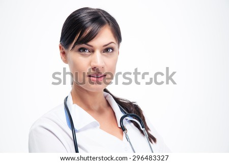 Medical doctor woman with stethoscope standing isolated on white background. Looking at cmaera - stock photo