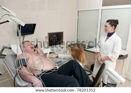 Medical doctors performing cardiology test - stock photo