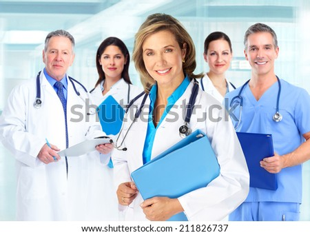 Medical doctors team over blue hospital background - stock photo