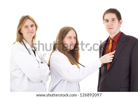 Medical doctors with patient - stock photo