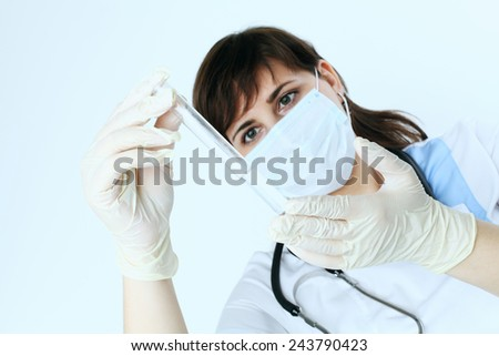 Medical equipment in female doctor hand - stock photo