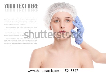 Medical face examination of beautiful woman by hands in glove - close-up portrait isolated on white - stock photo