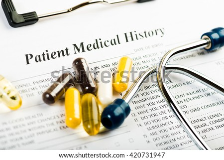 Medical history document with medicine and stethoscope  - stock photo