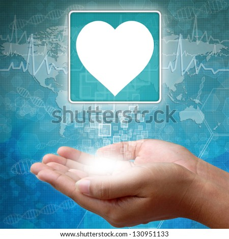 Medical icon Heart in hand - stock photo
