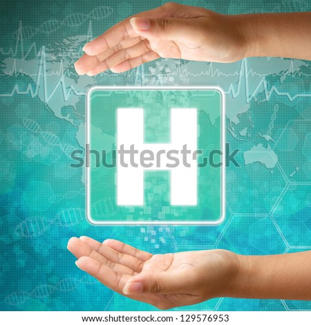 Medical icon Hospital in hand - stock photo