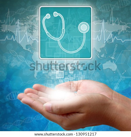 Medical icon Stethoscope in hand - stock photo