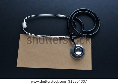 Medical idea conceptual with envelope and stethoscope. Insurance or business concept - stock photo