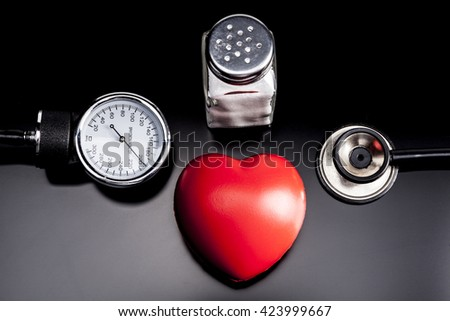 Medical instrument on black plate with shadow - stock photo