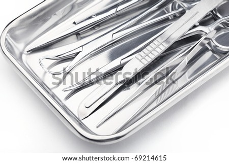 Medical instruments in a steel tray - stock photo