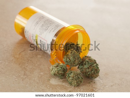 Medical Marijuana in prescription bottle - stock photo