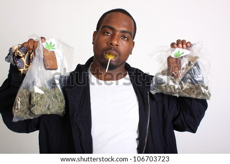 Medical marijuana patient holding marijuana products. - stock photo
