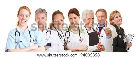 Medical nursing team with doctors, nurses and caregivers - stock photo
