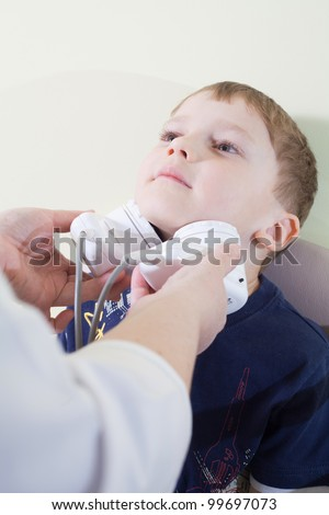 Medical otitis examination of a little child at a ear nose throat doctor - stock photo