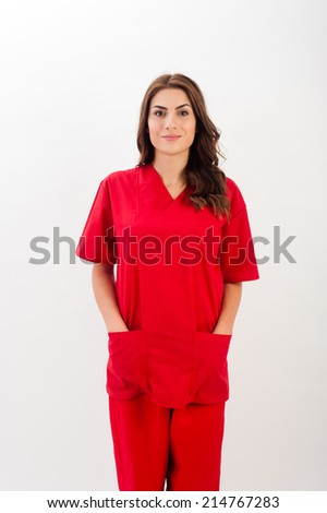 Medical person: Nurse / young doctor portrait. Confident young woman medical professional isolated on white background. Young pretty caucasian female model. - stock photo
